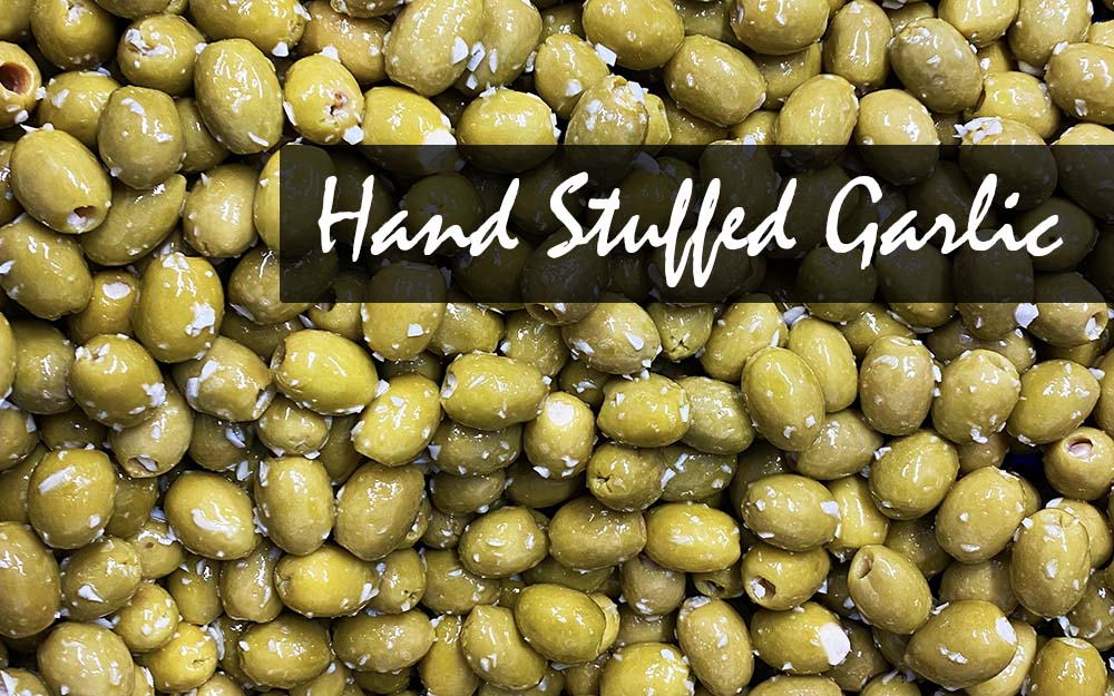 Hand-Stuffed Garlic Banner Image West Country Olives in oil